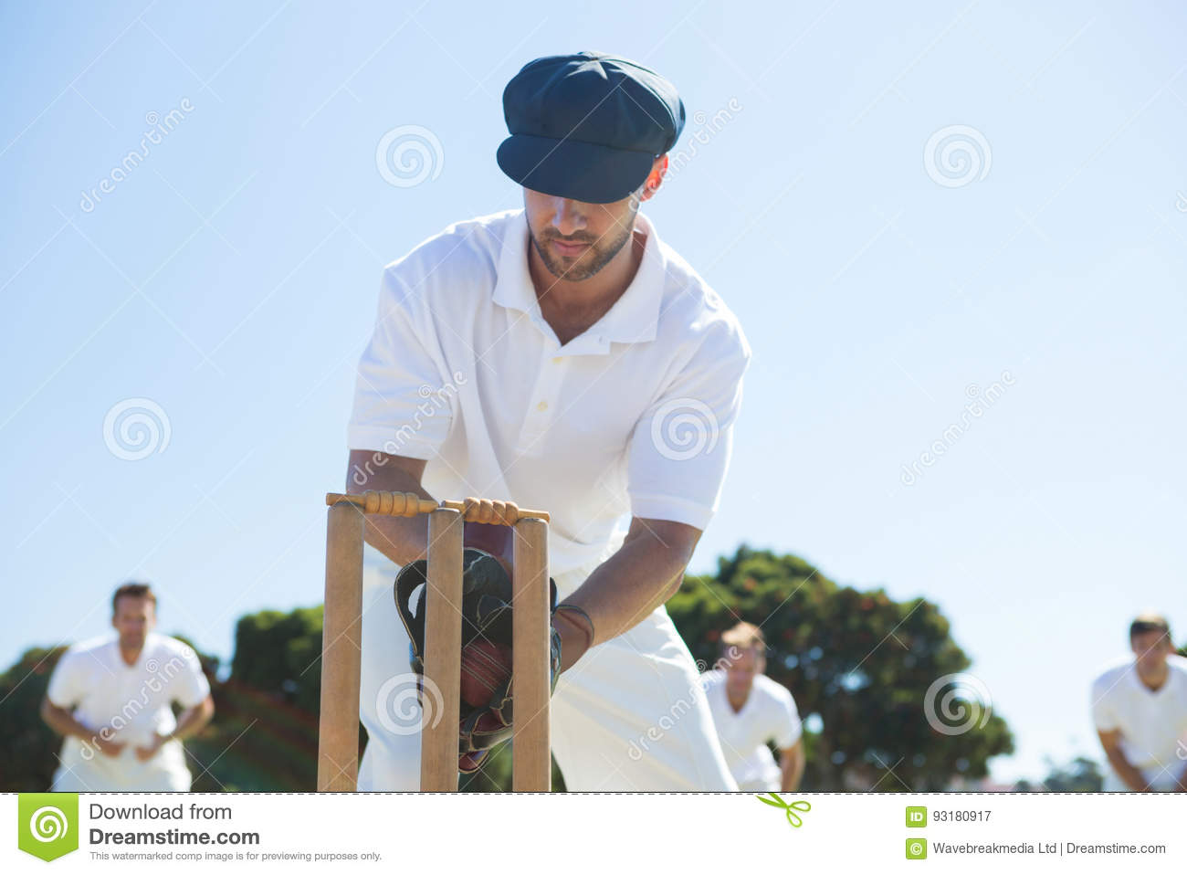 Close up of wicket keeper standing by stumps