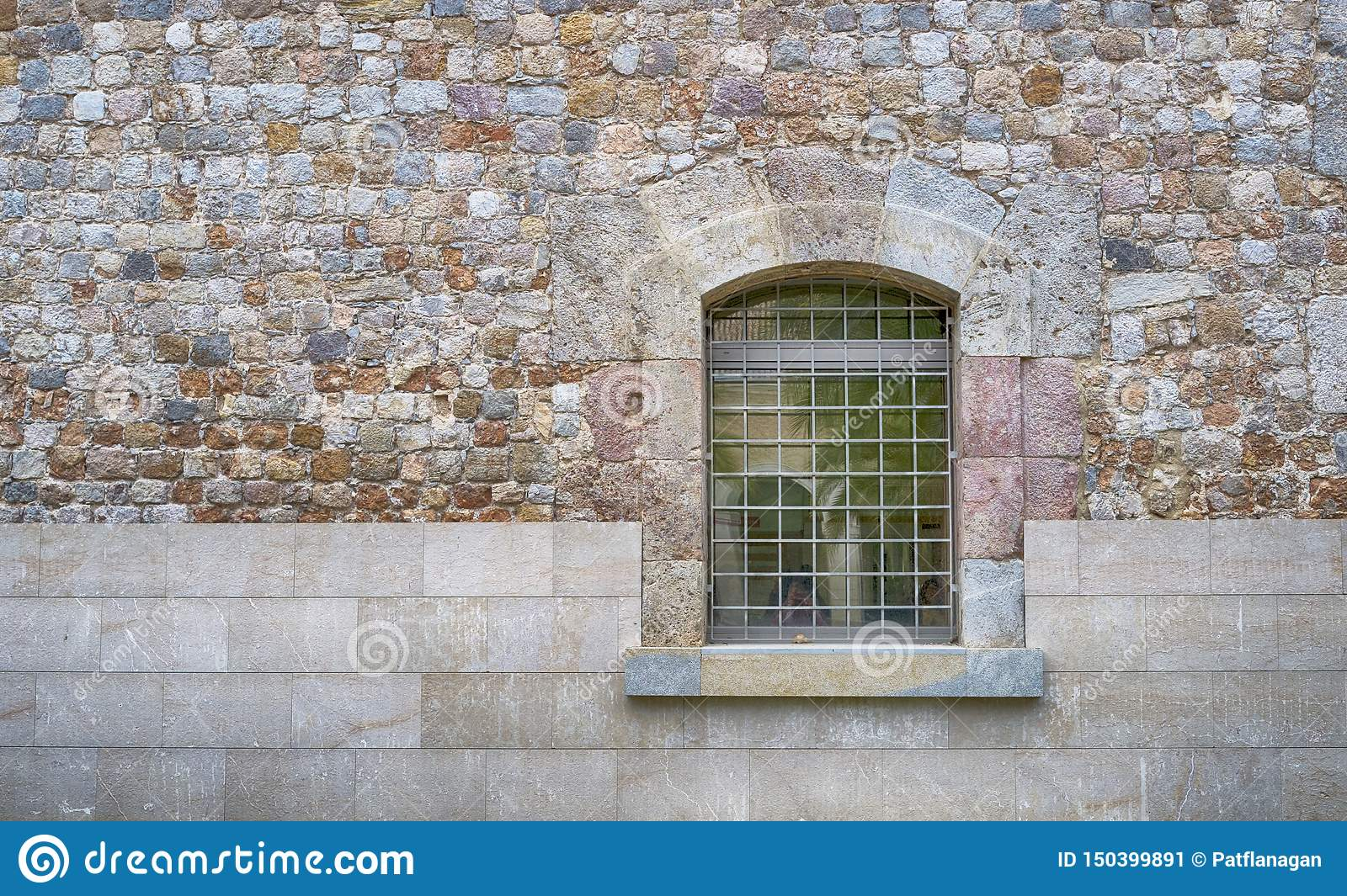 Close up of a window with bars and wall