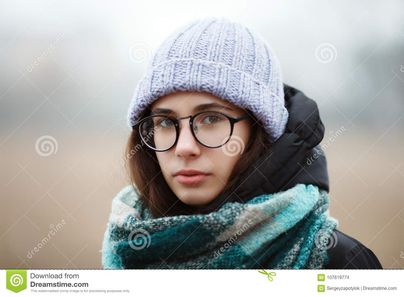 Close up winter portrait young cute brunette girl strolling winter forest park.
