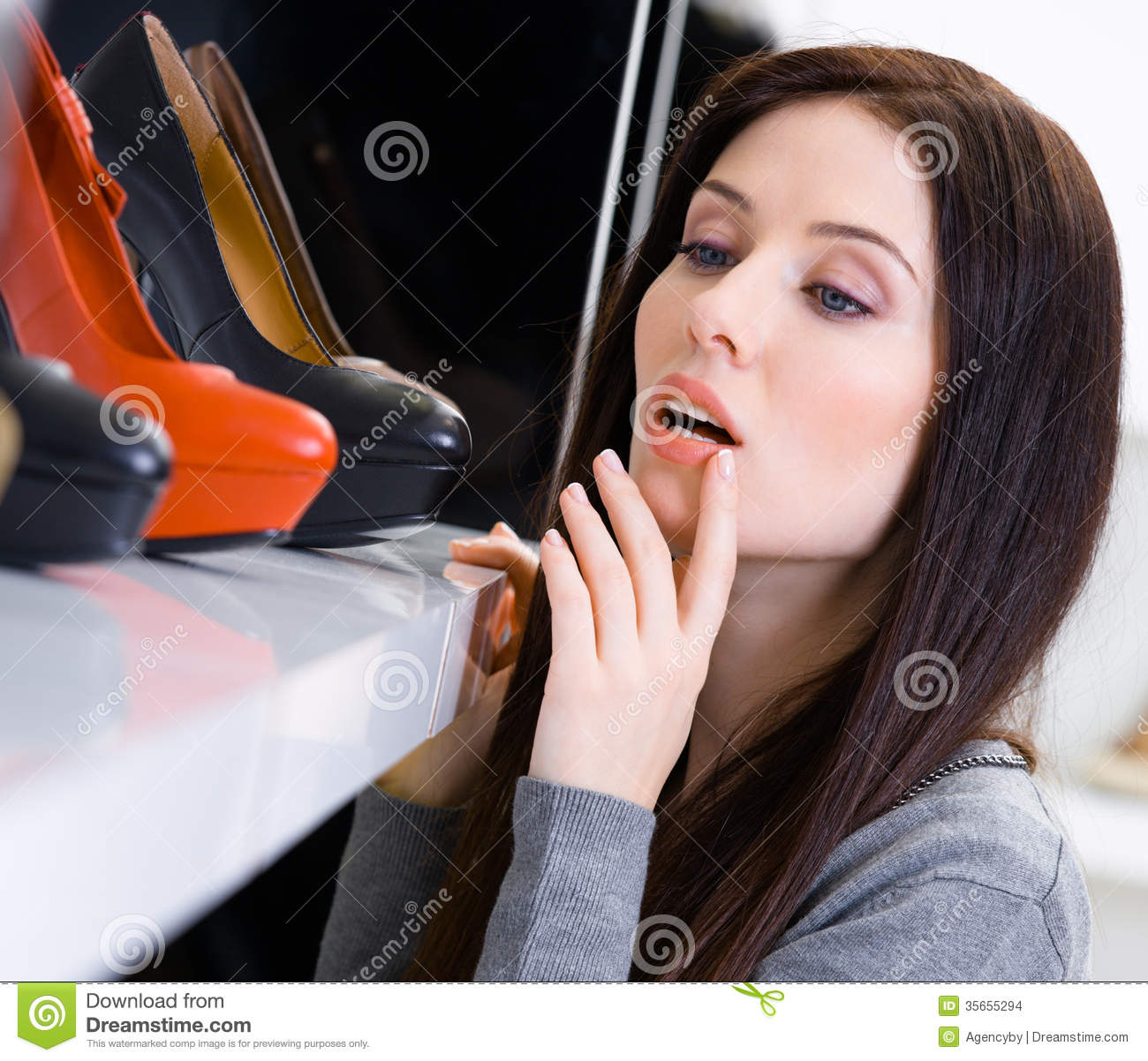 Close up of woman choosing a pair of shoes