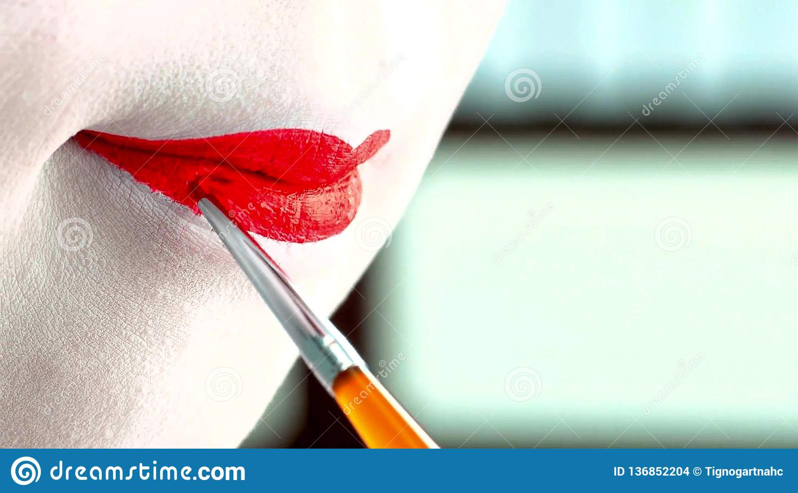 Close up of a woman with classic japanese make up on her lips. Geisha with red lips