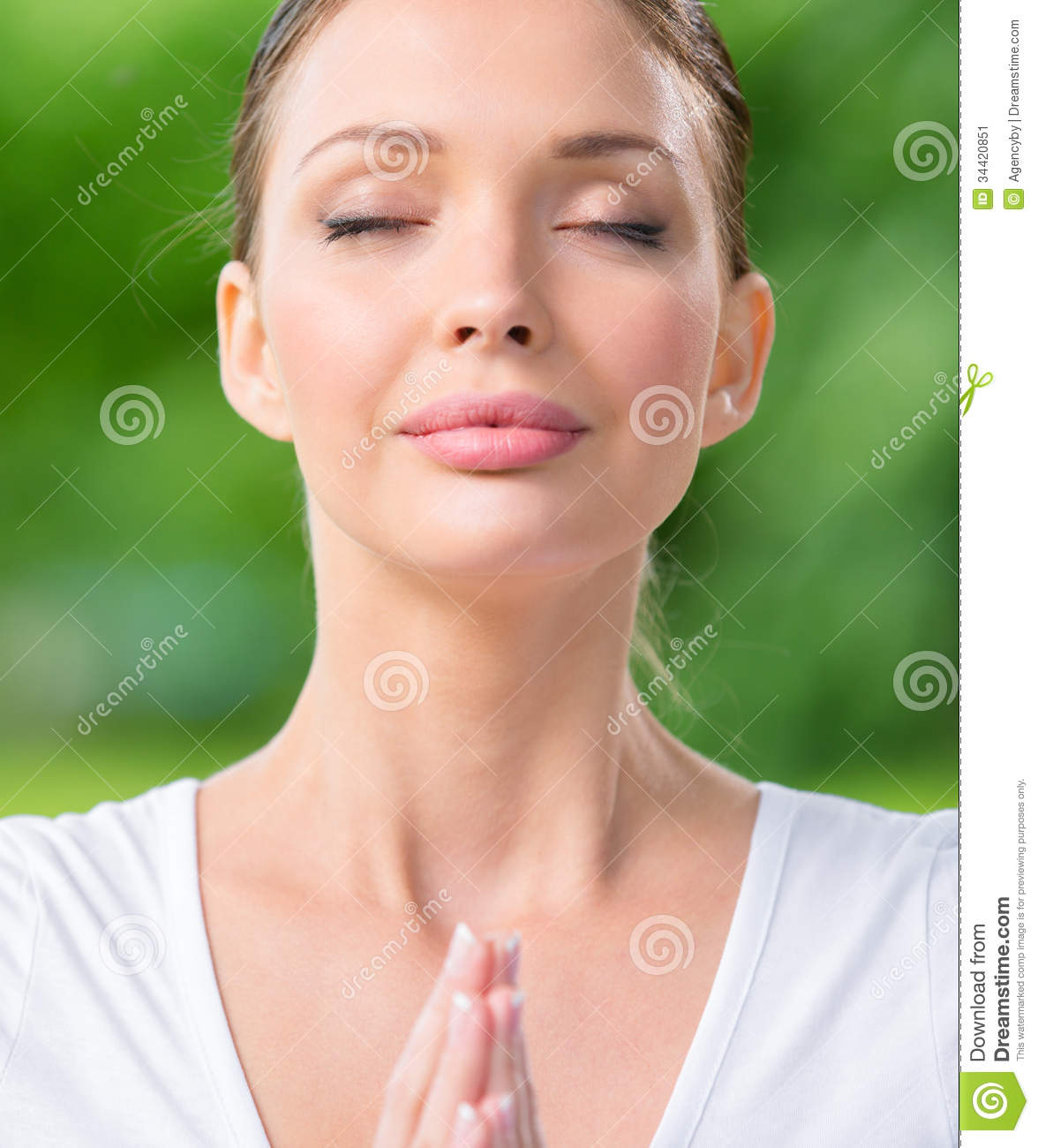 Close Up Of Woman With Closed Eyes Prayer Gesturing Stock