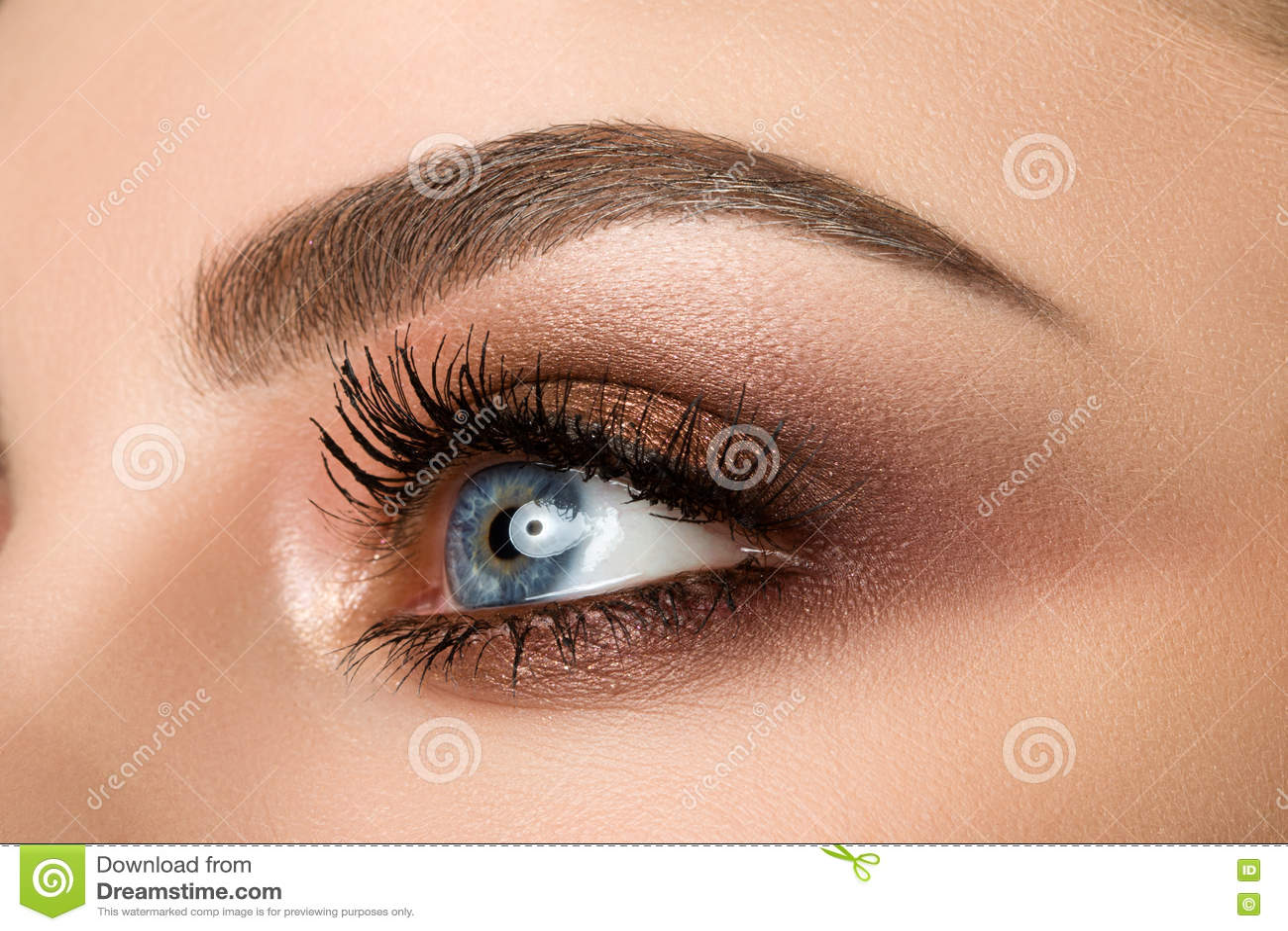 Close Up Of Woman Eye With Beautiful Brown Smokey Eyes Makeup Stock