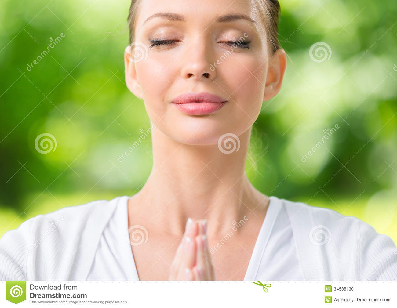Close up of woman with eyes closed prayer gesturing