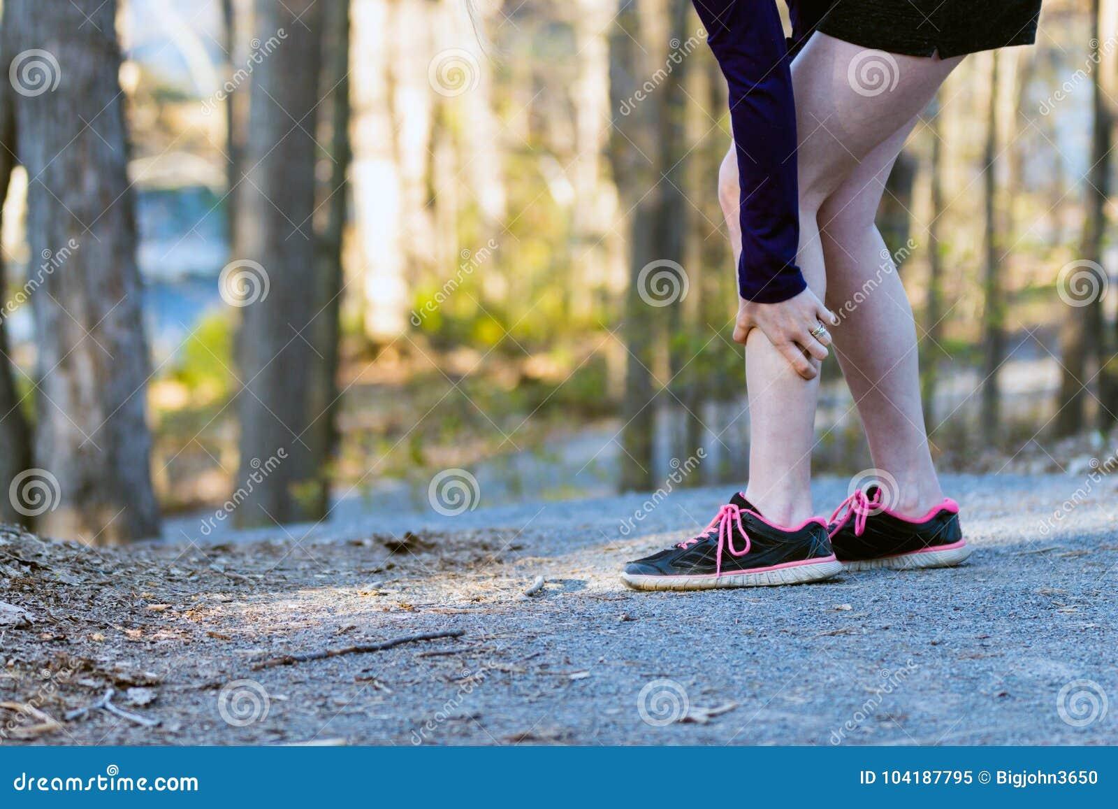 1879e3916dd1 Sports Injury Leg Cramp On Running Trail. Stock Image - Image of ...
