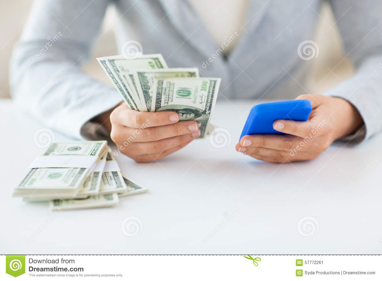 Close up of woman hands with smartphone and money