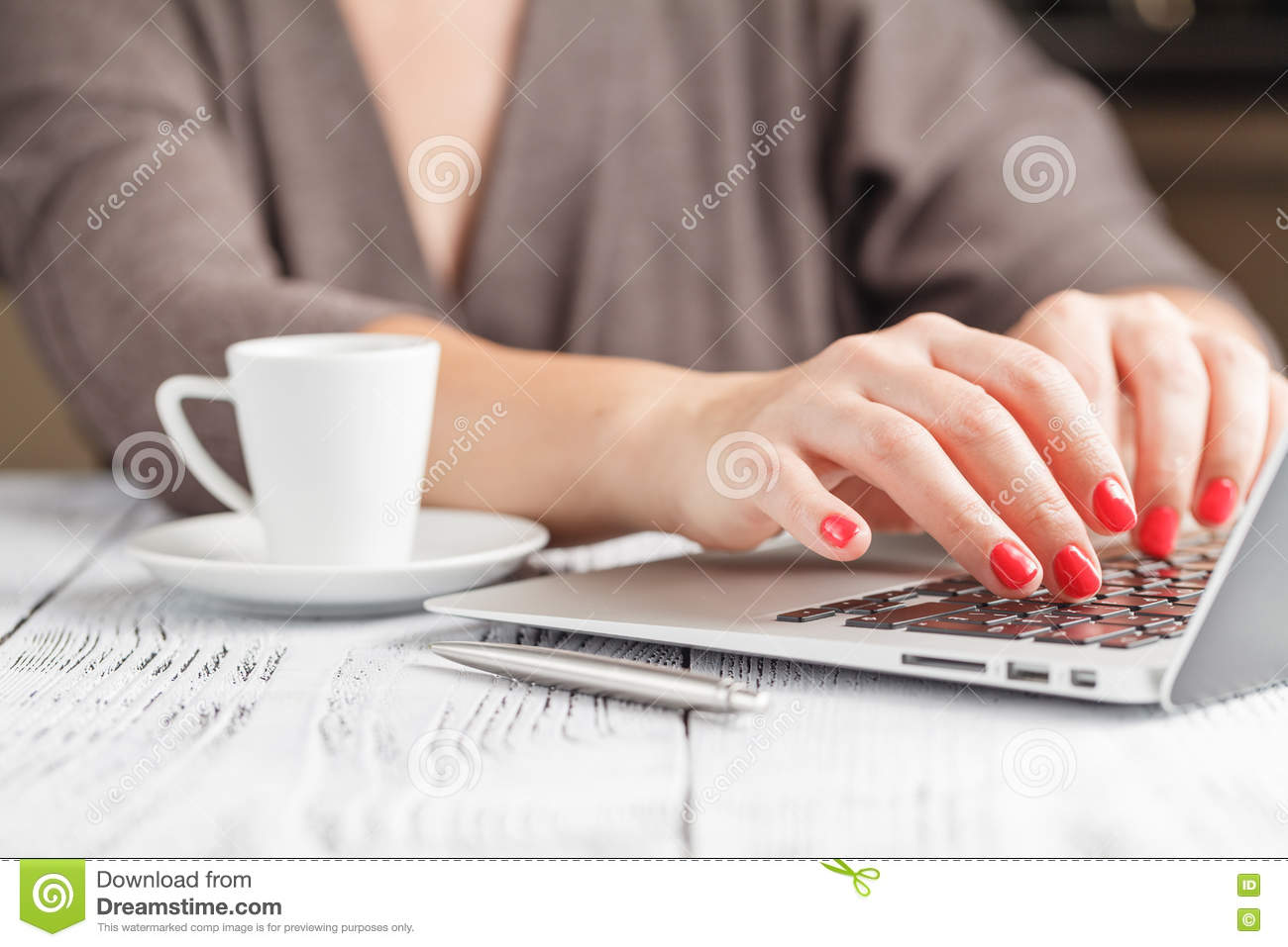 close up of a woman hands typing in a laptop in a coffee shop te stock photo image 78438361. Black Bedroom Furniture Sets. Home Design Ideas