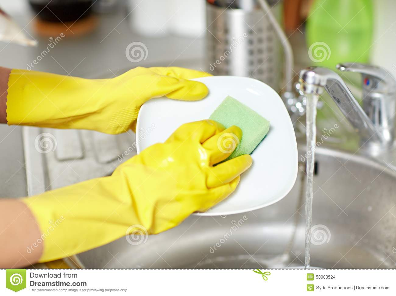 Close Up Of Woman Washing Hands At Kitchen Sink Stock