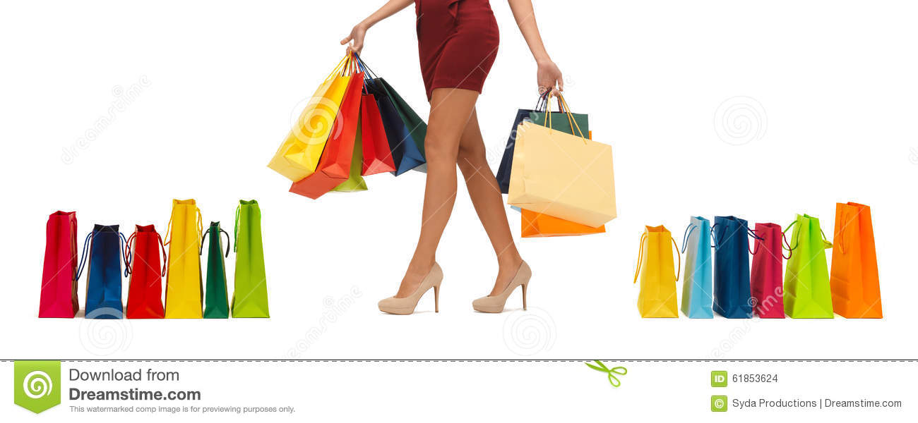 Close up of woman on high heels with shopping bags