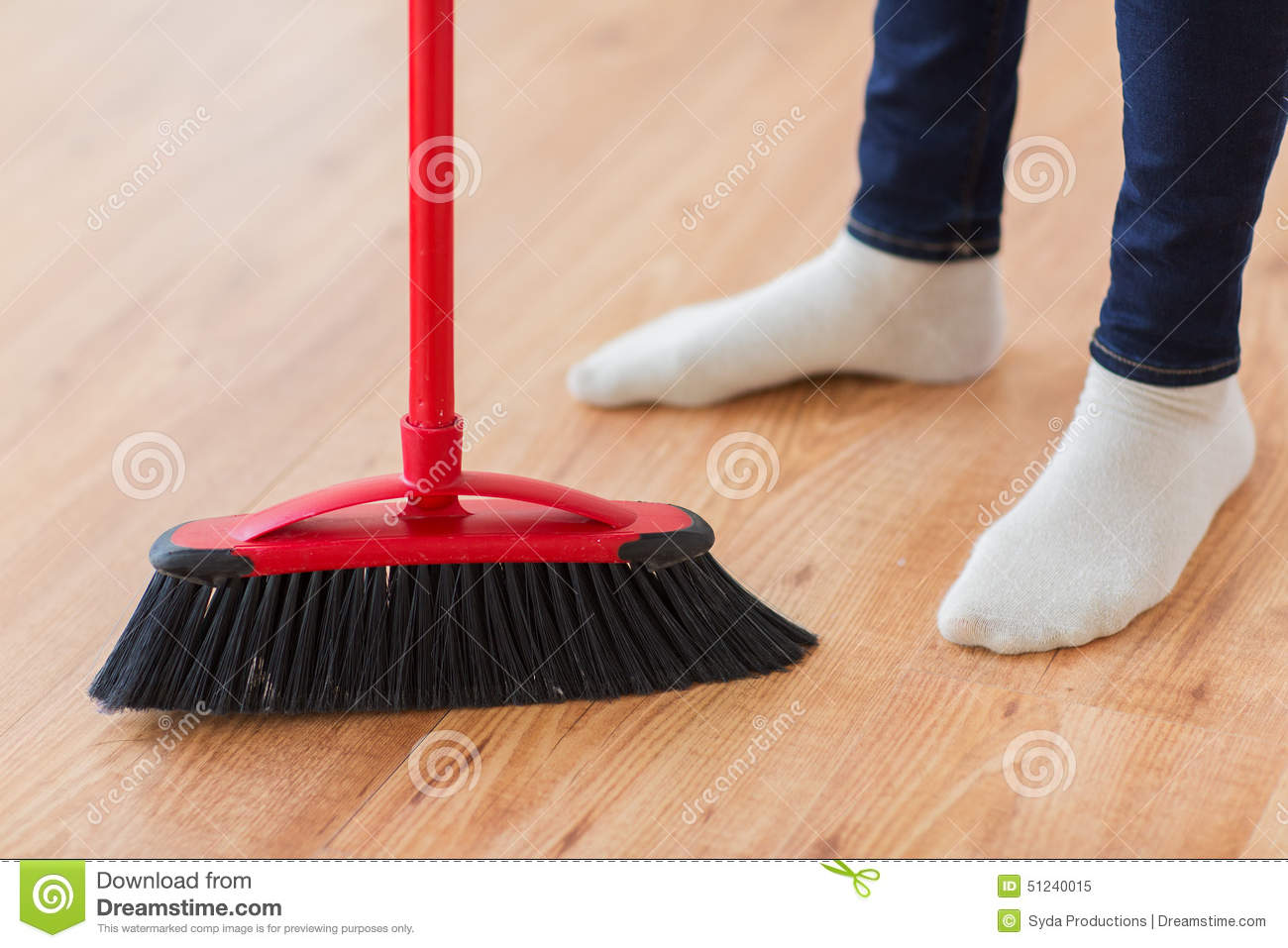 Close Up Of Woman Legs With Broom Sweeping Floor Stock