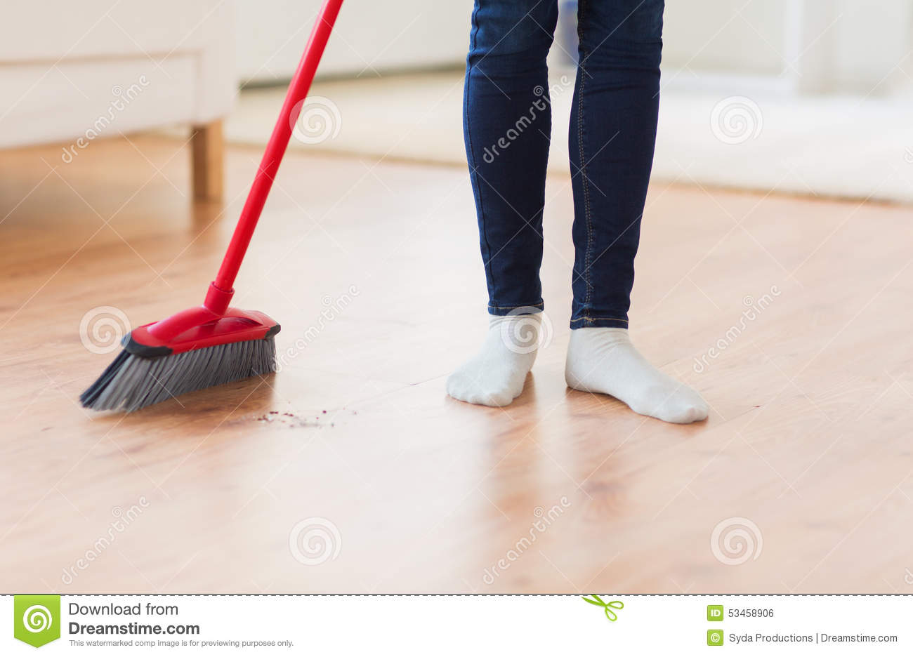 close up of woman legs with broom sweeping floor stock photo image of girl housewife 53458906 dreamstime com