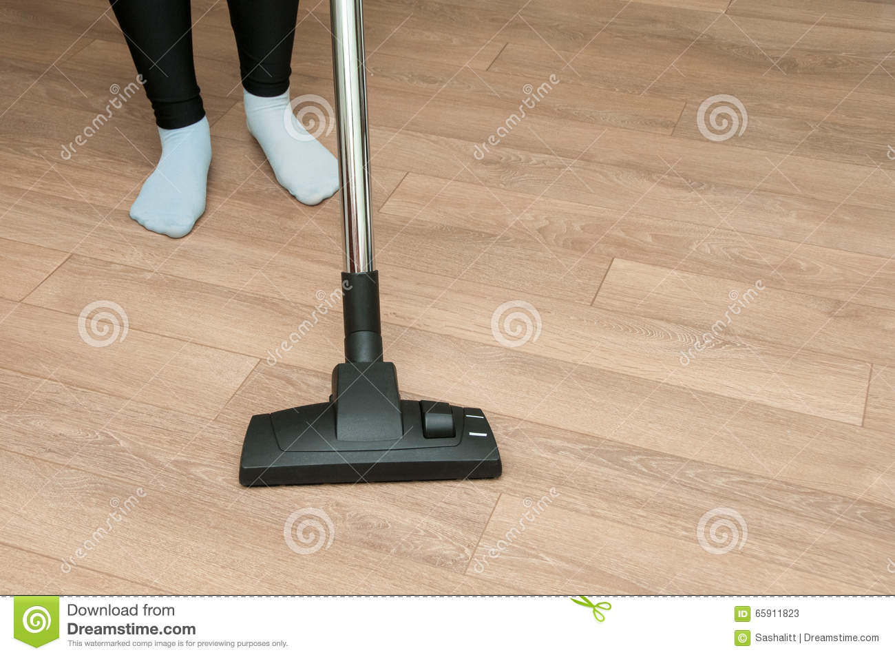 Woman legs with vacuum cleaner cleaning floor stock photo for Floor someone