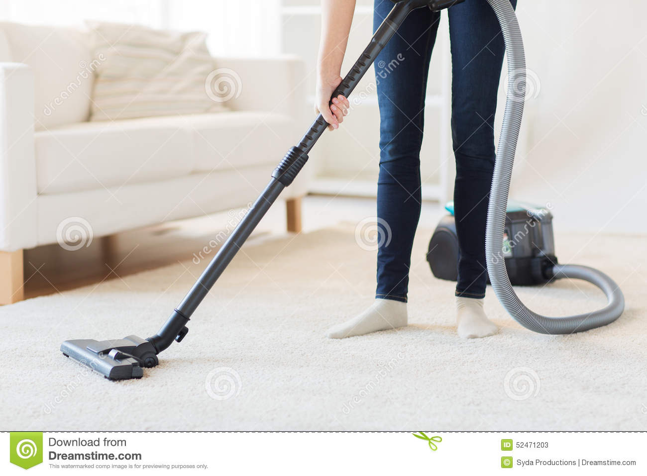 Close Up Of Woman Legs With Vacuum Cleaner At Home Stock