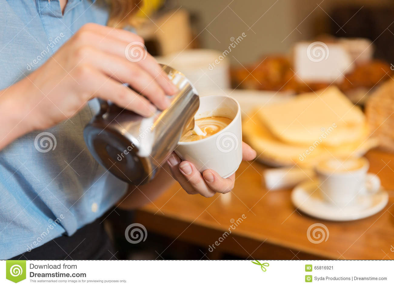 close up of woman making coffee at shop or cafe stock photo image 65816921. Black Bedroom Furniture Sets. Home Design Ideas