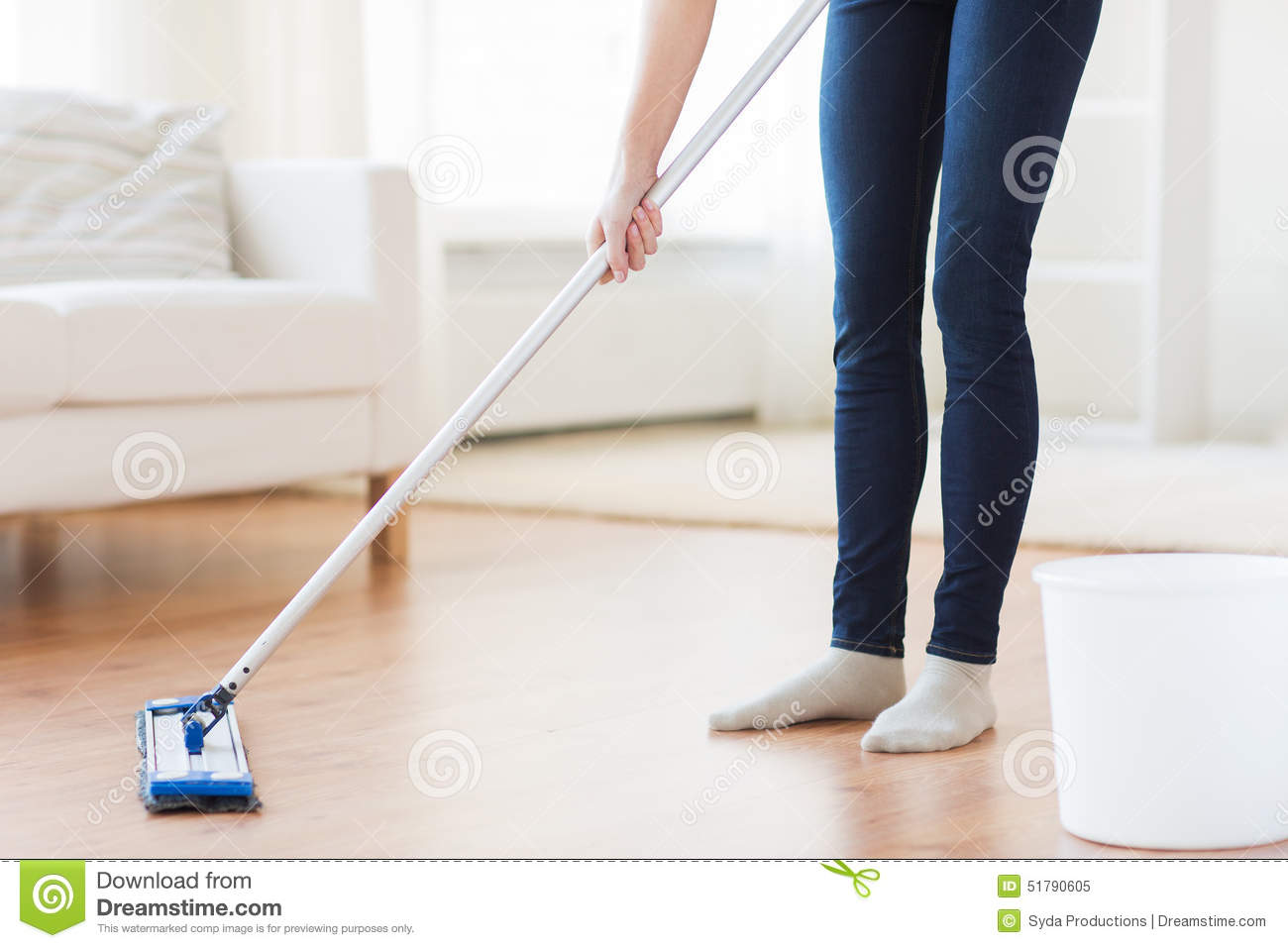 Close up of woman with mop cleaning floor at home stock for Floor someone