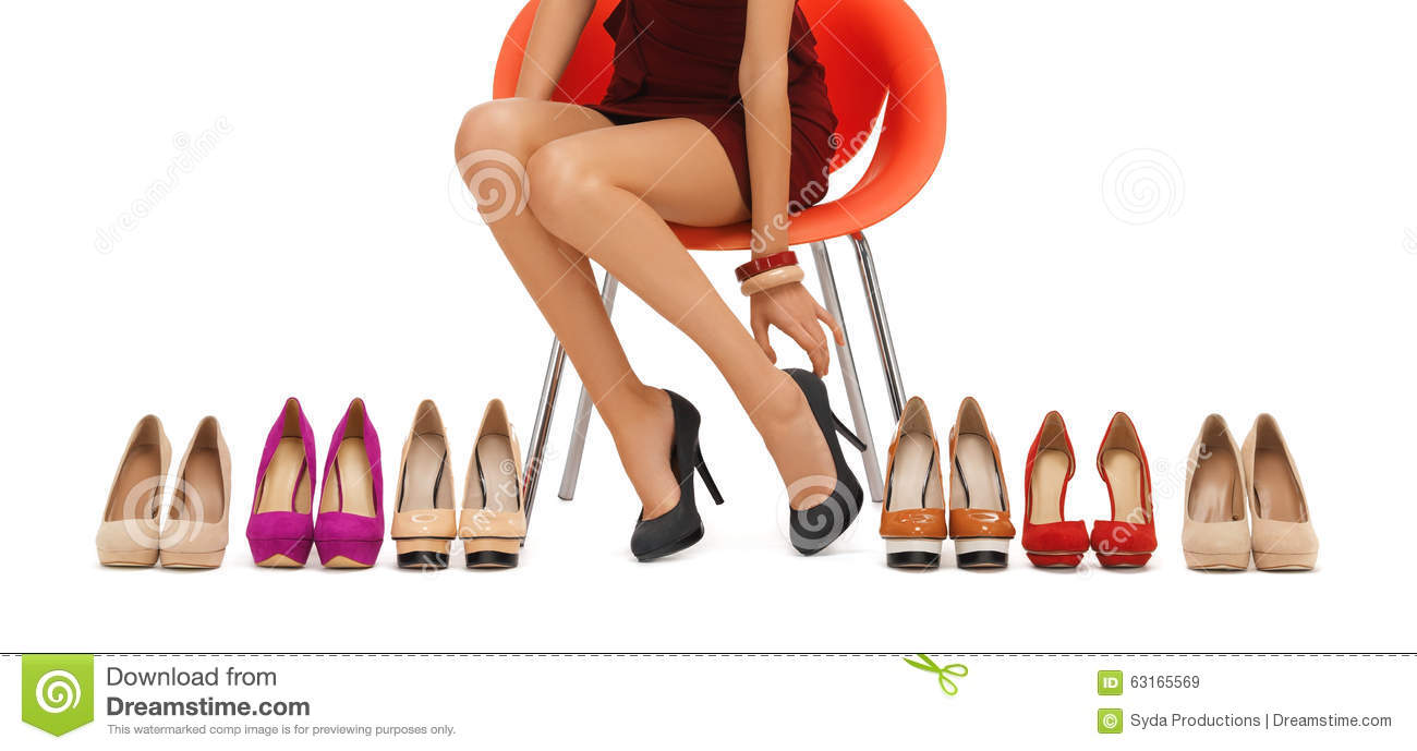 Close up of woman trying on high heeled shoes