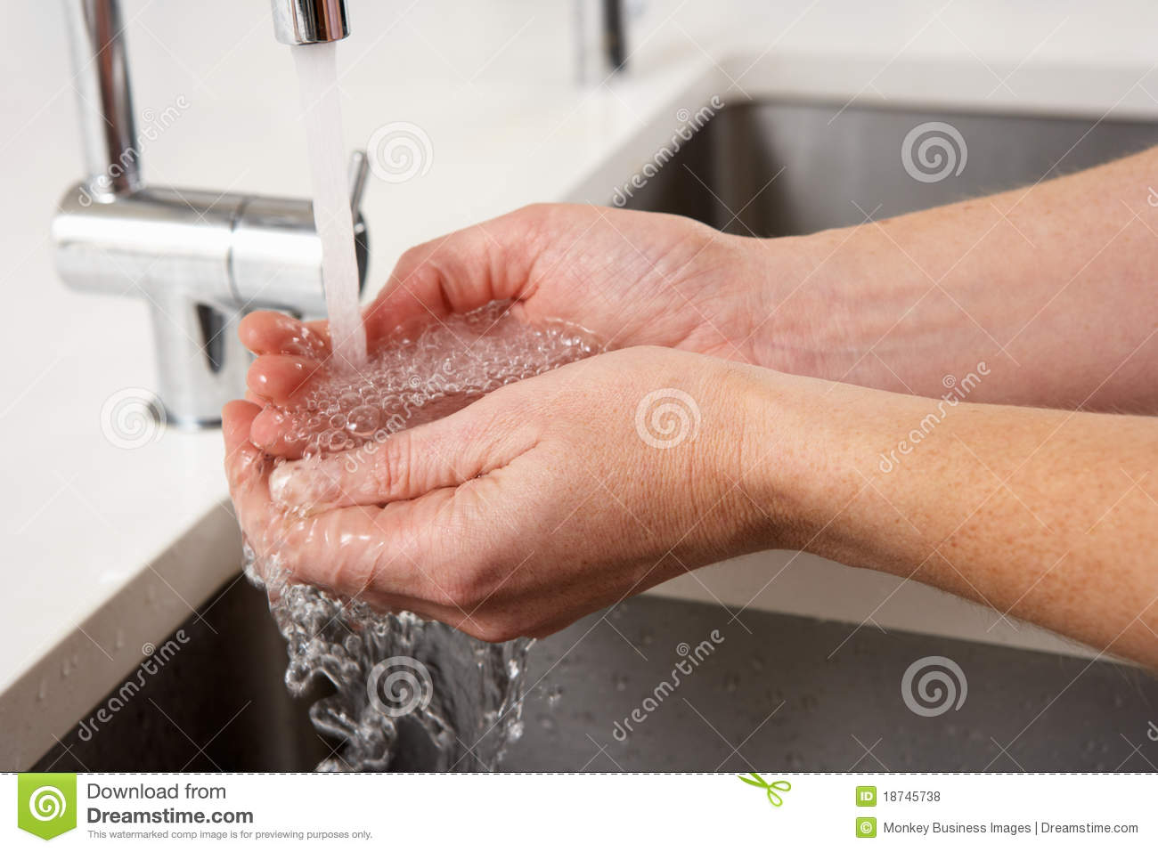 Close Up Of Woman Washing Hands At Kitchen Sink Royalty