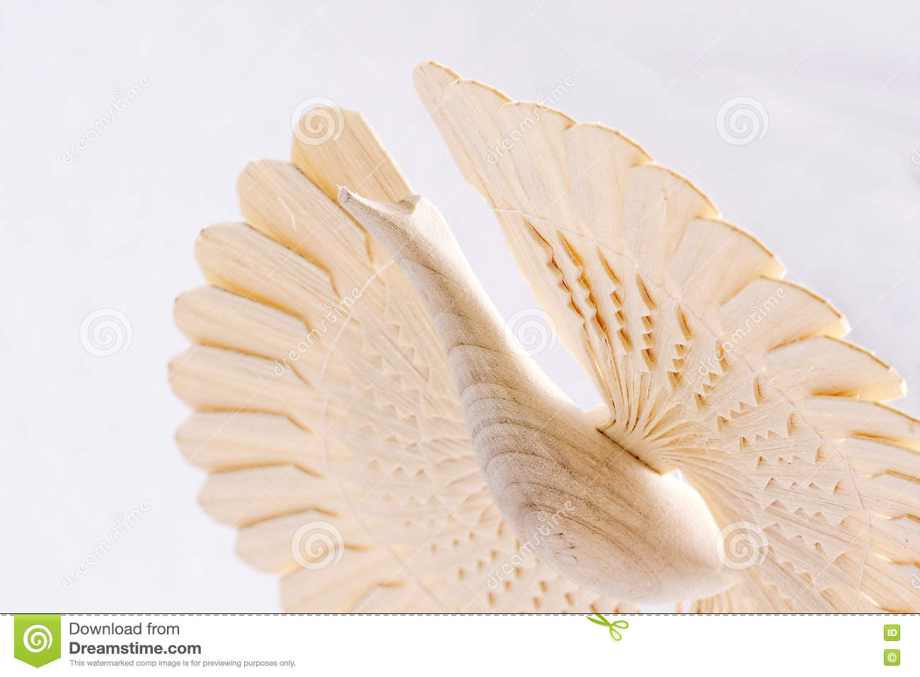 Close-up wooden bird of happiness. Firebird traditional russian family symbol