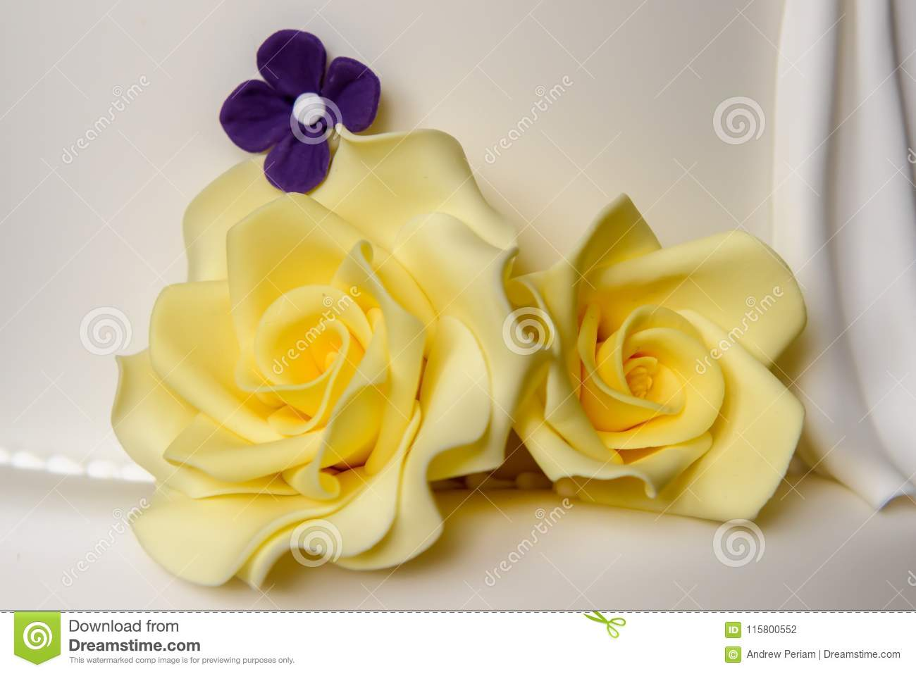 Yellow And Purple Icing Flowers Stock Photo - Image of decorated ...
