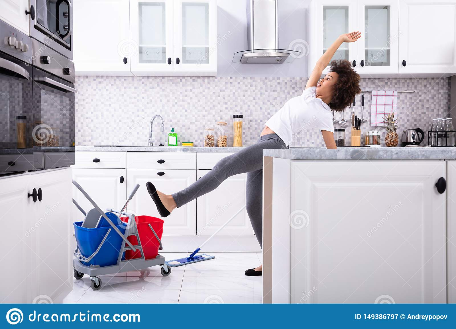 Woman Slipping While Mopping Floor In Kitchen Stock Image   Image ...