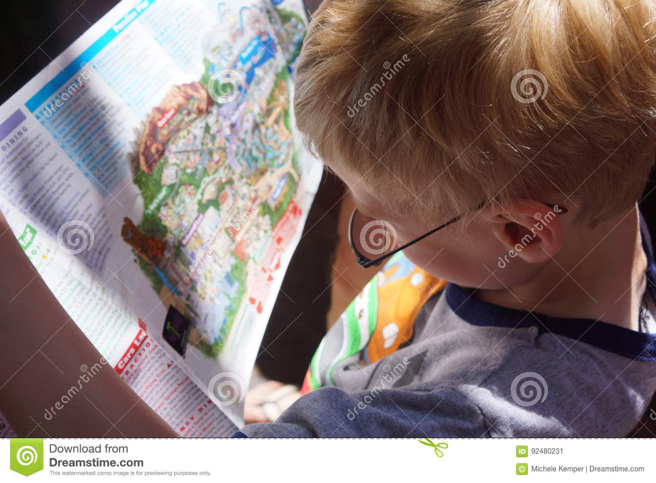 Young Boy Reading Map
