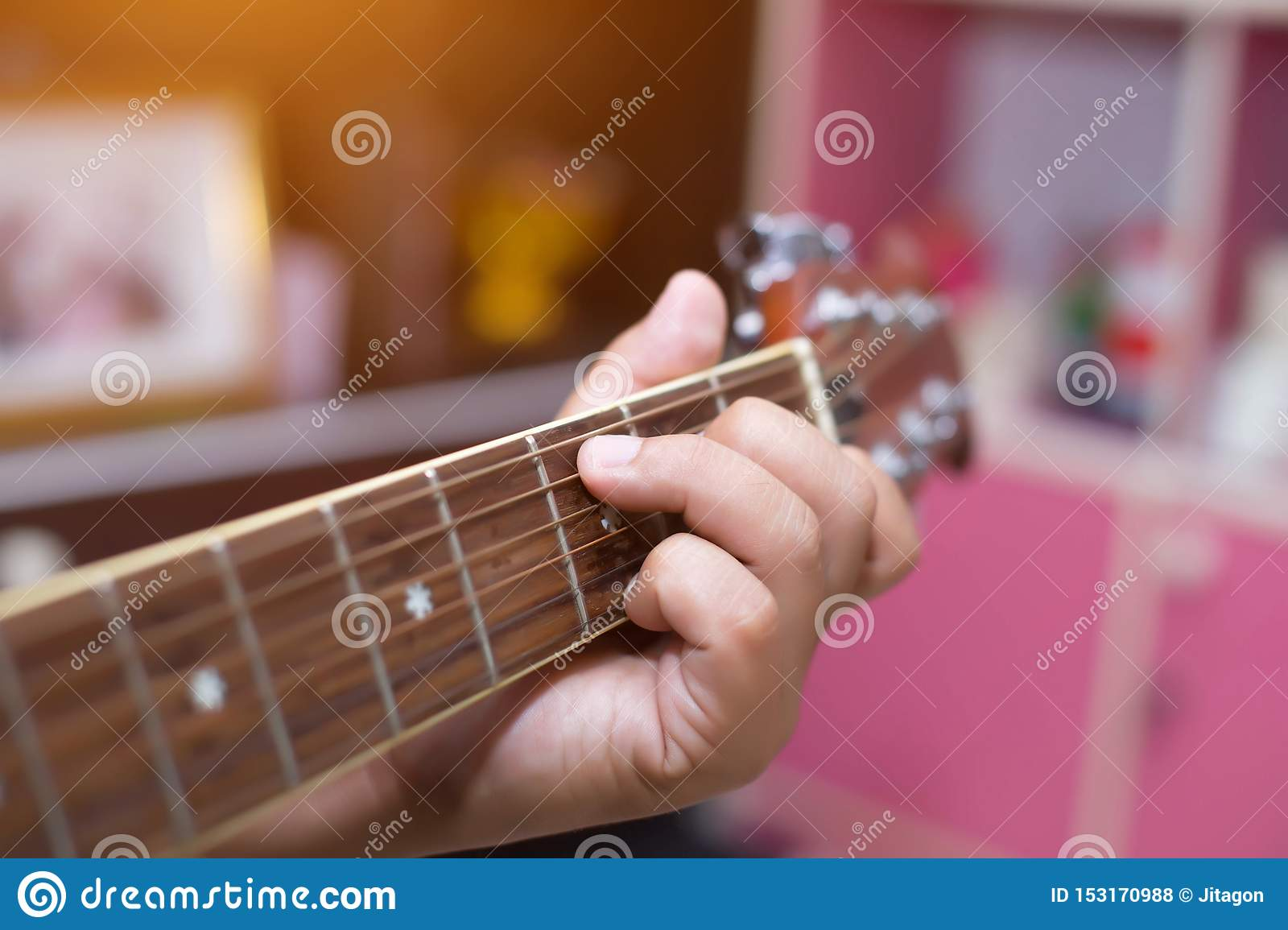 Close up of young hipster woman practiced guitar in the park,happy and enjoy playing guitar