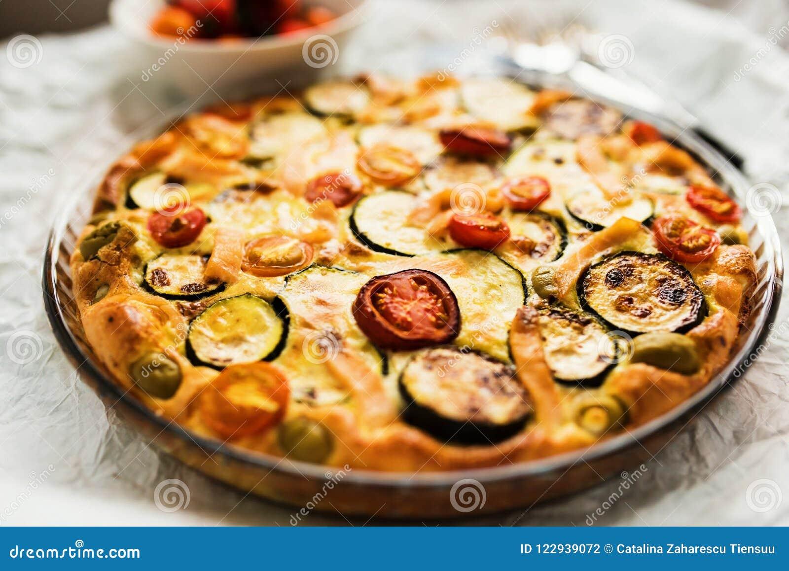 Close-up of Zucchini, tomatoes and cheese tart