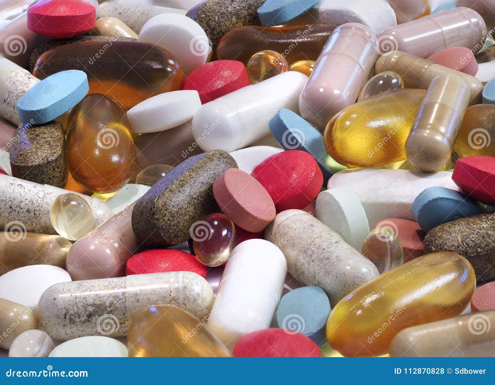 Close-upnadruk Gestapeld Beeld van een verscheidenheid van Pillen, Capsules, en