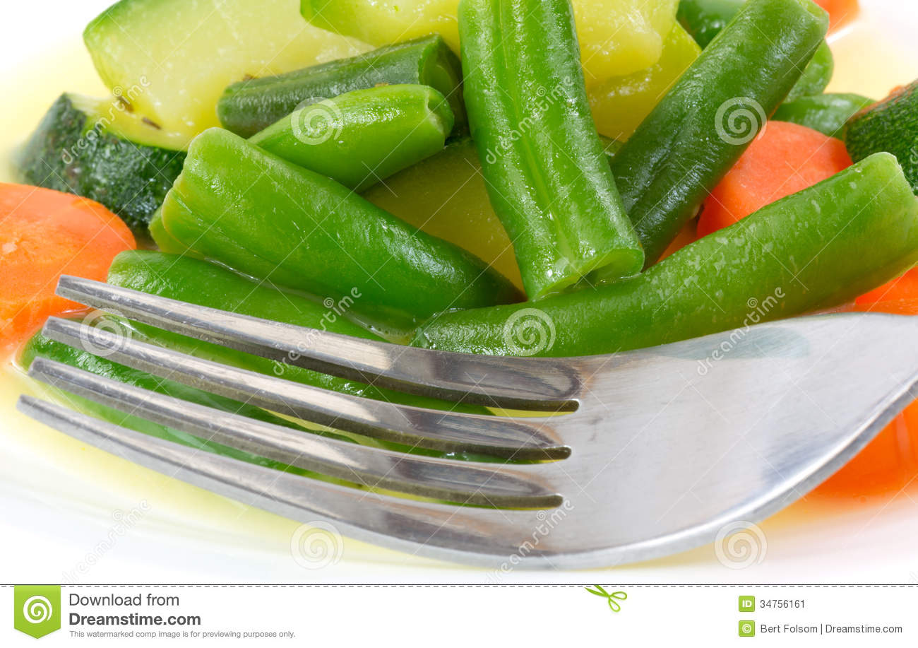 view of cooked green beans, carrots and zucchini in light butter sauce ...