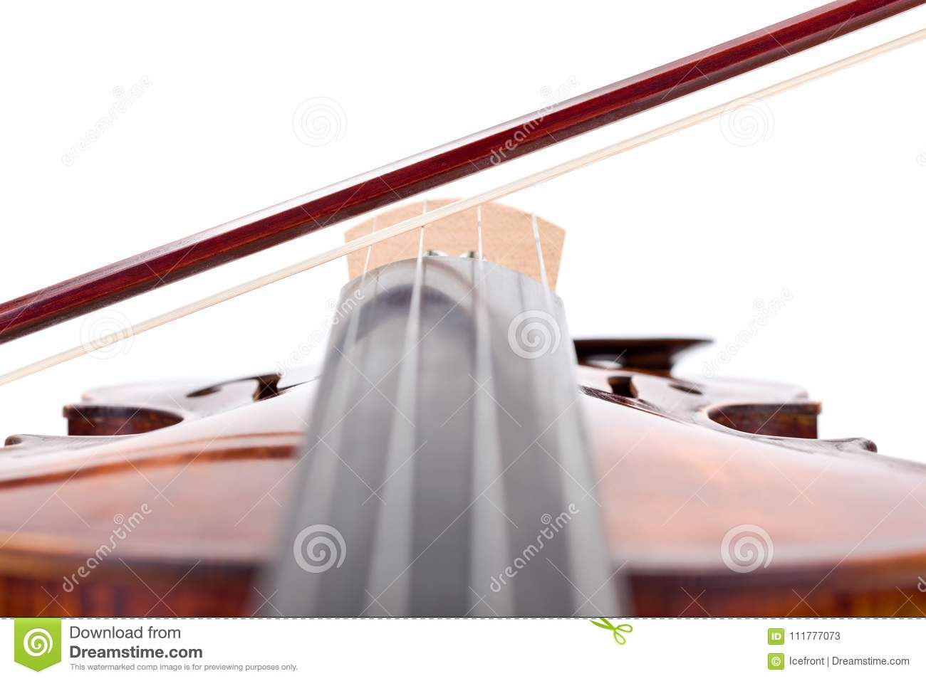 Close view of a violin bow on strings