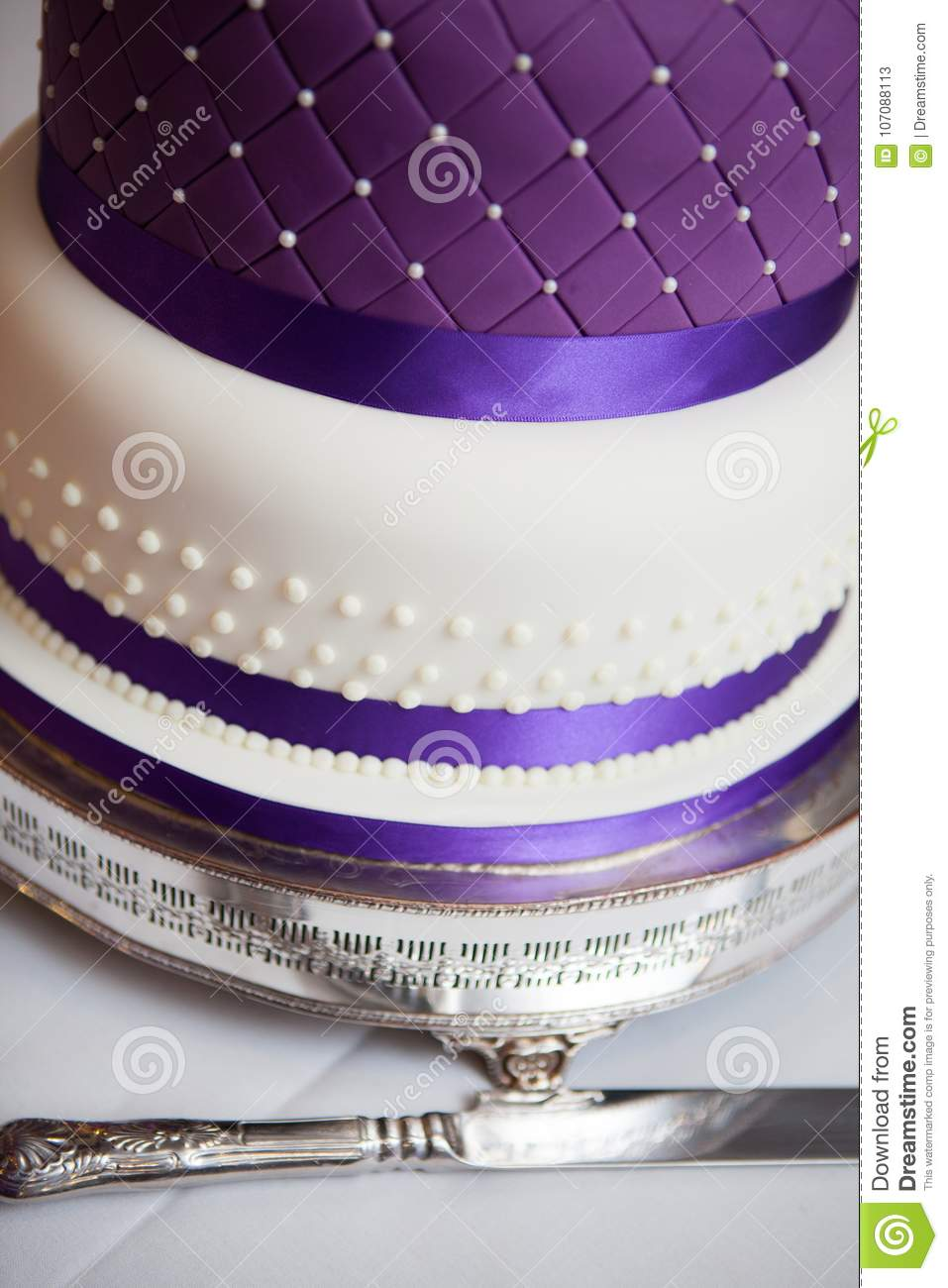 A Close Of A Wedding Cake With Purple Ribbon Stock Image - Image of ...