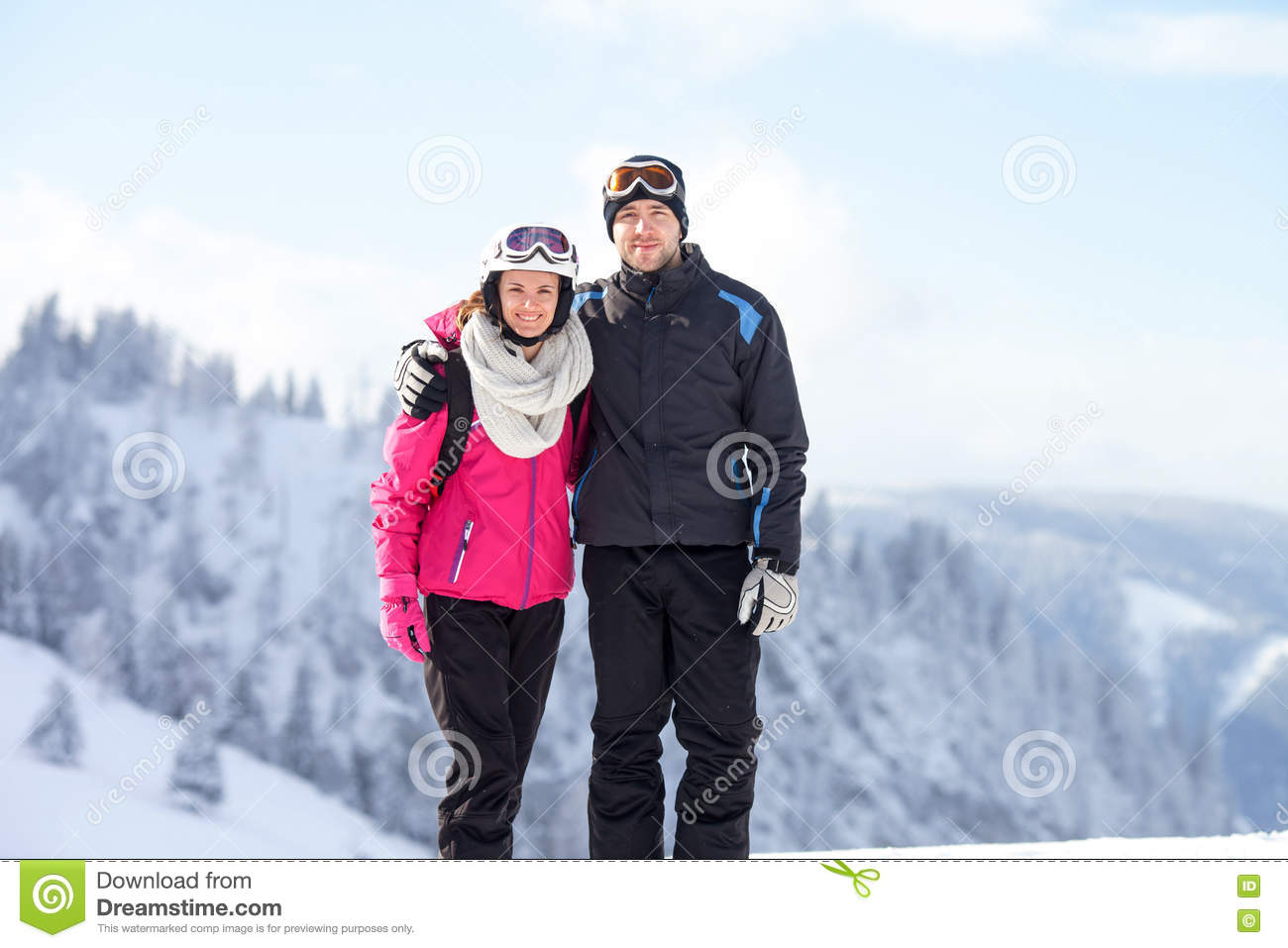 Close winter portrait of brother and sister, skiing