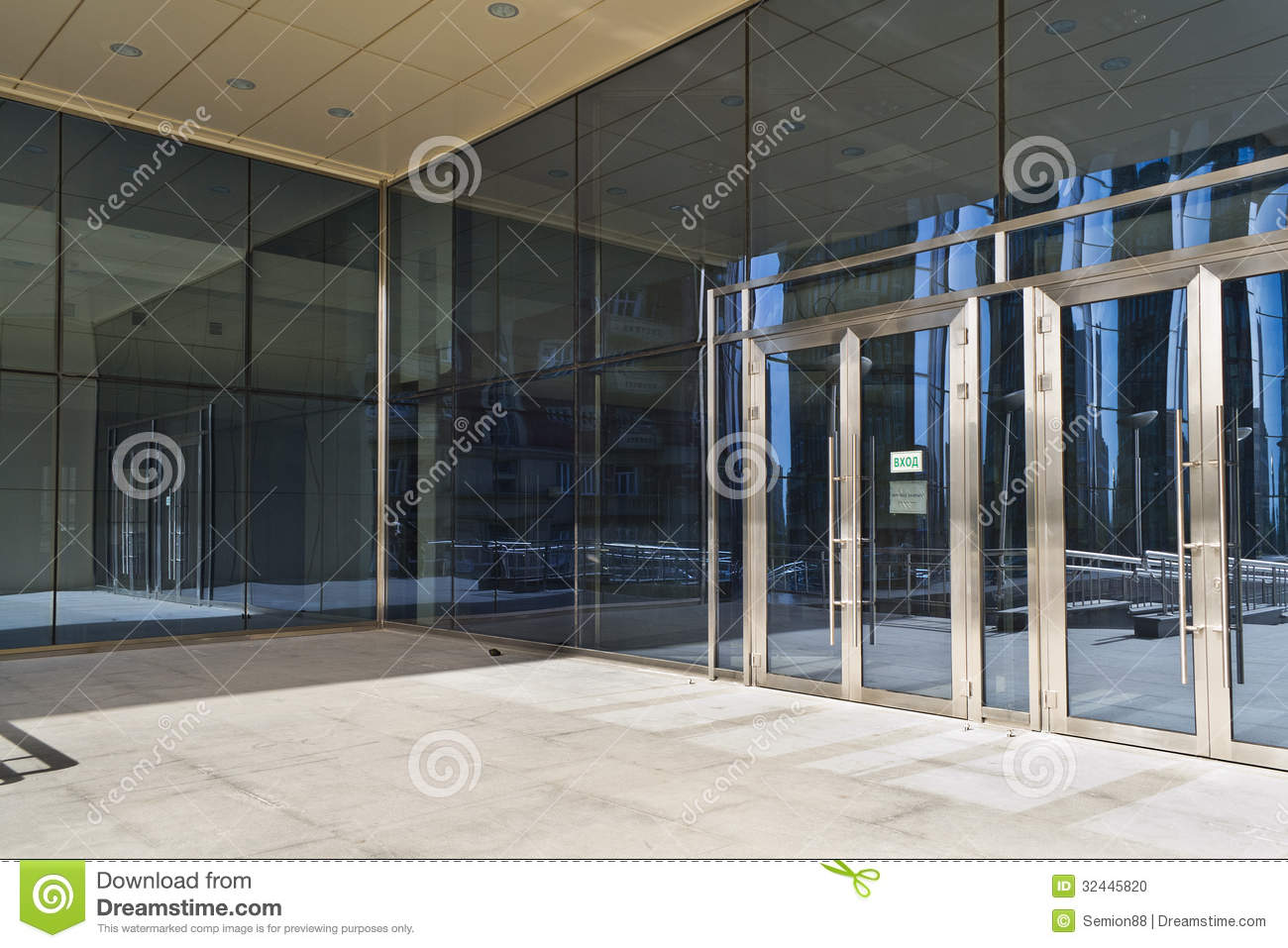 Closed Doors In Modern Large Glass Building Stock Photo