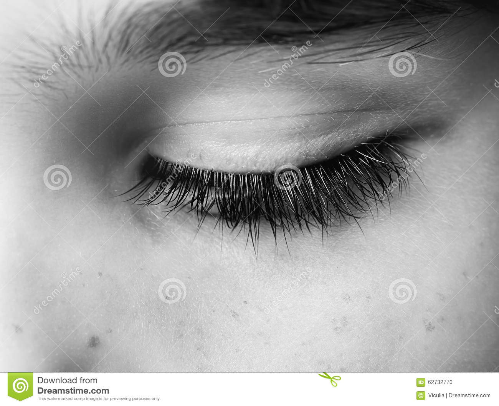 Closed human eye close up studio shot.