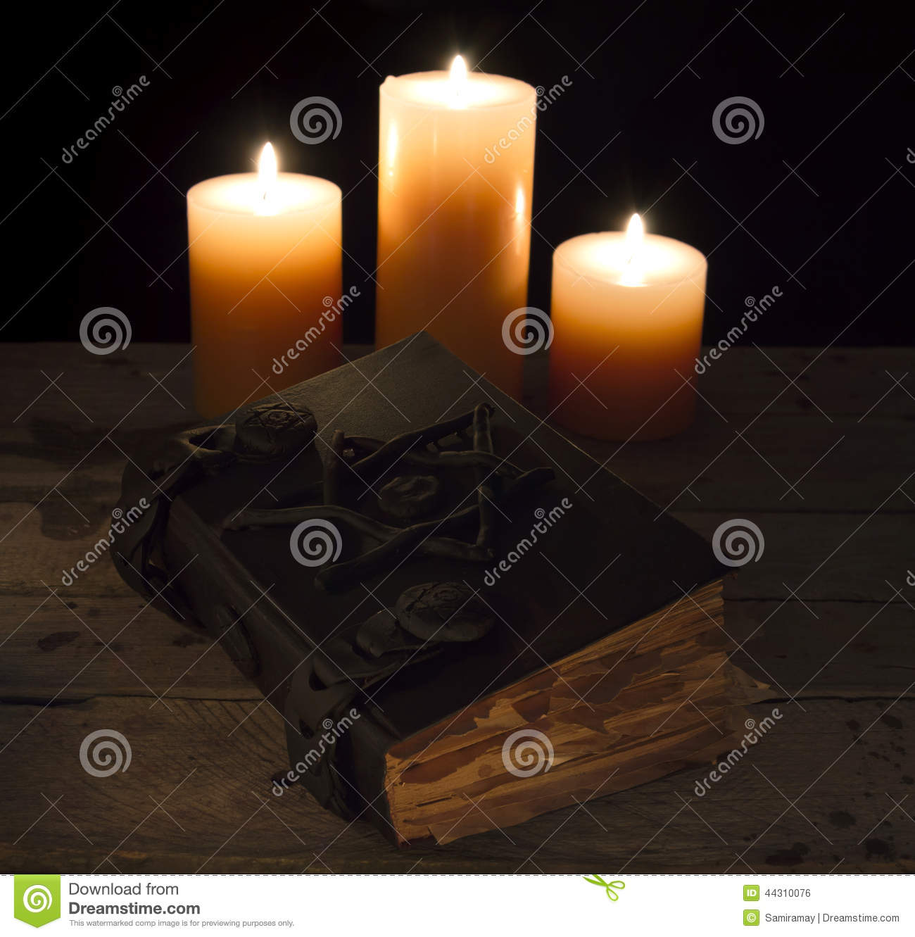 August 2014 Cpo Offers Table Jpg: Closed Magic Book With Candles Stock Photo
