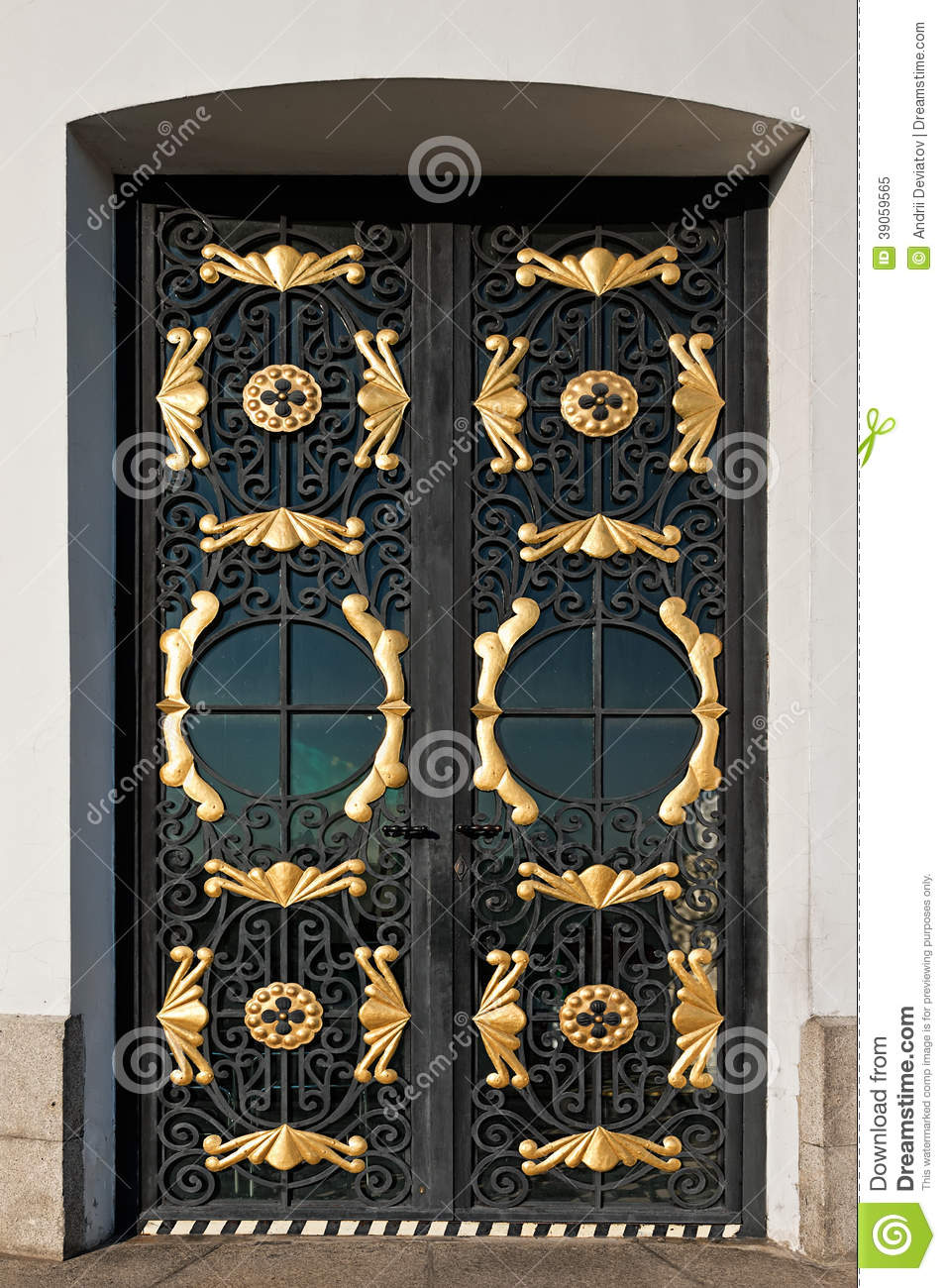 Decorative Metal Entry Doors : Closed metal door with decorative grille stock image