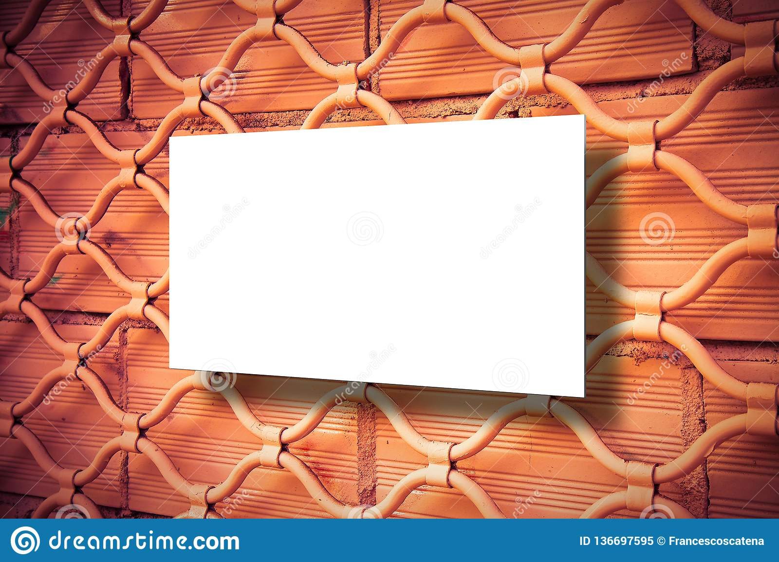 Closed metal gate of a shop after bankruptcy - concept image with blank billboard