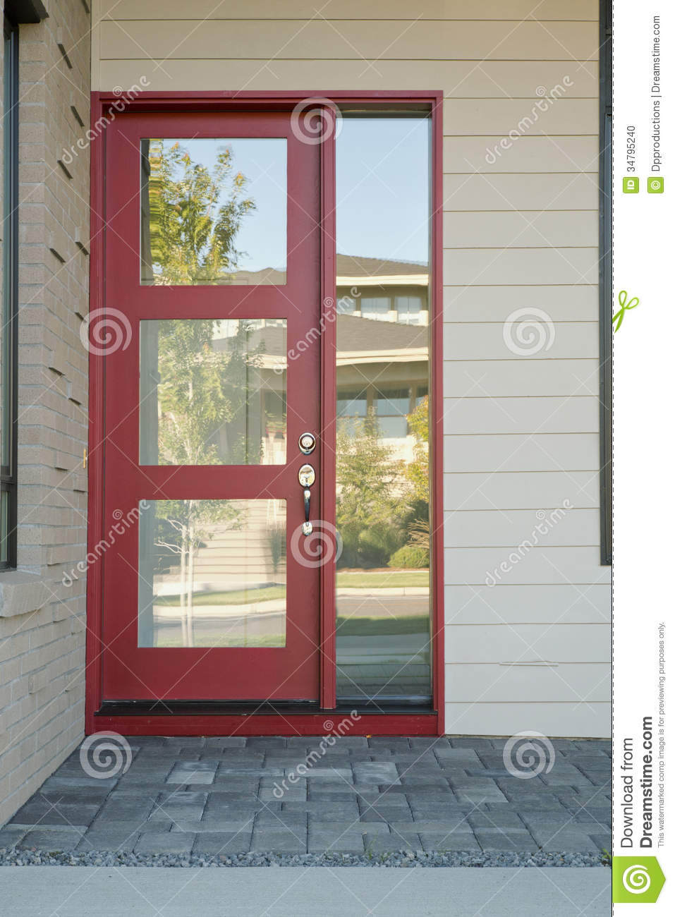 Closed Modern Red Exterior Door Of A Home Stock Photo