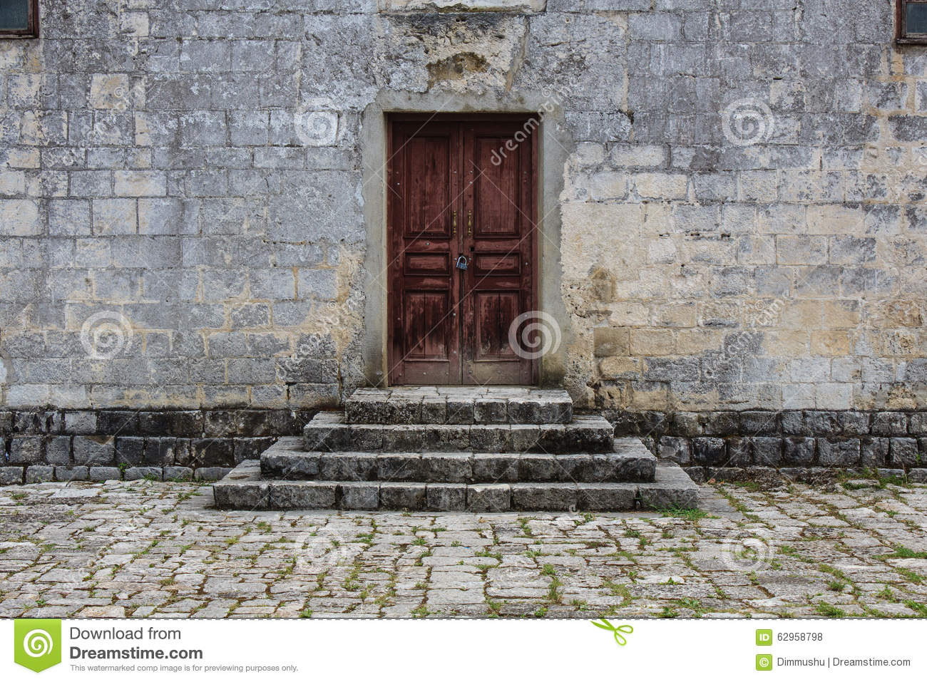 Closed Obsolete Wooden Door And Stone Bricks Steps Ancient Building