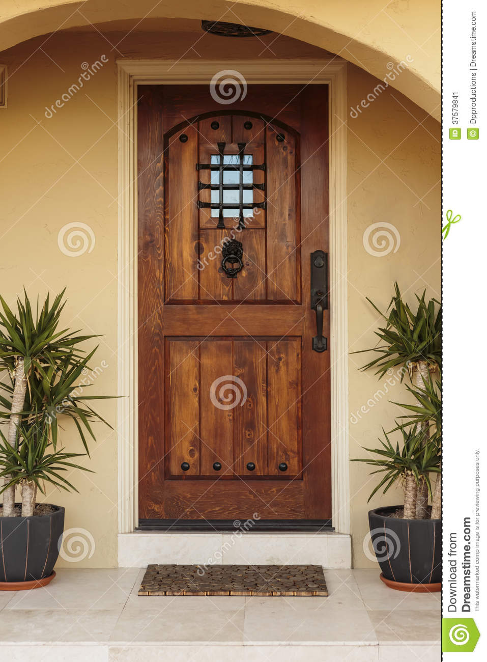 Closed Ornate Front Door Of An Upscale Stucco House Stock