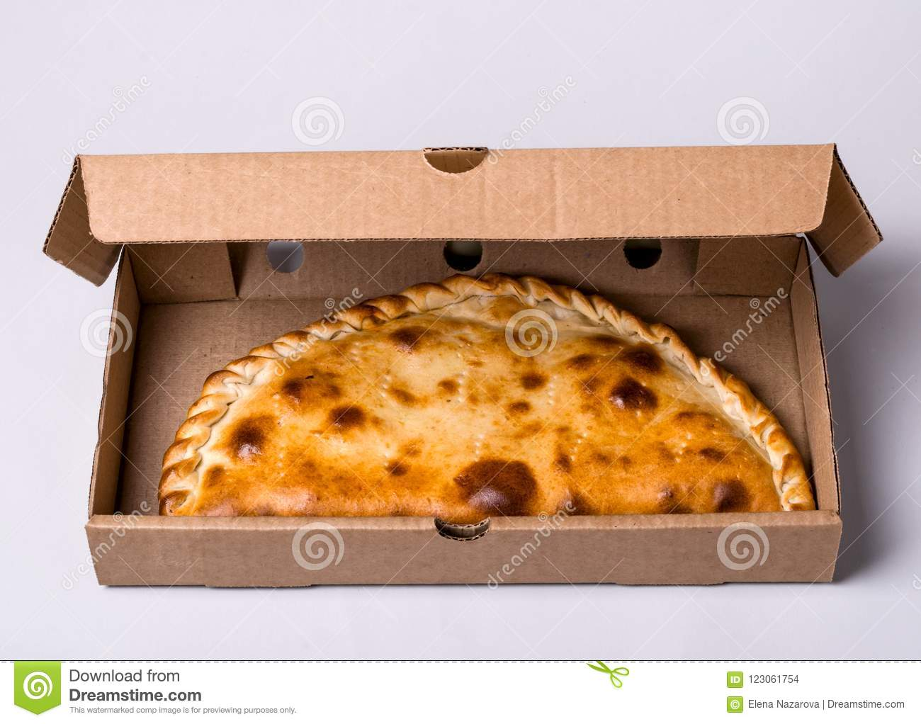 Closed Pizza Calzone In Packing Box On Gray Background Stock