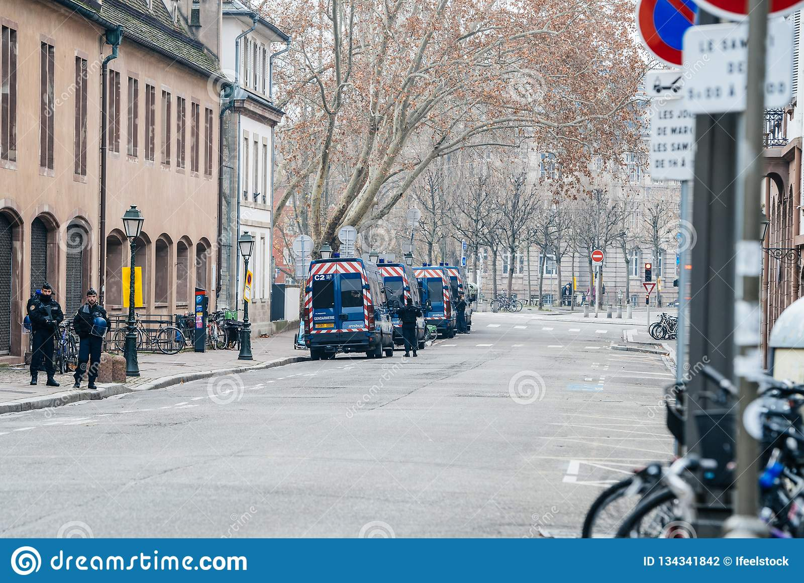 Closed street with police vans and police officer in Strasbourg