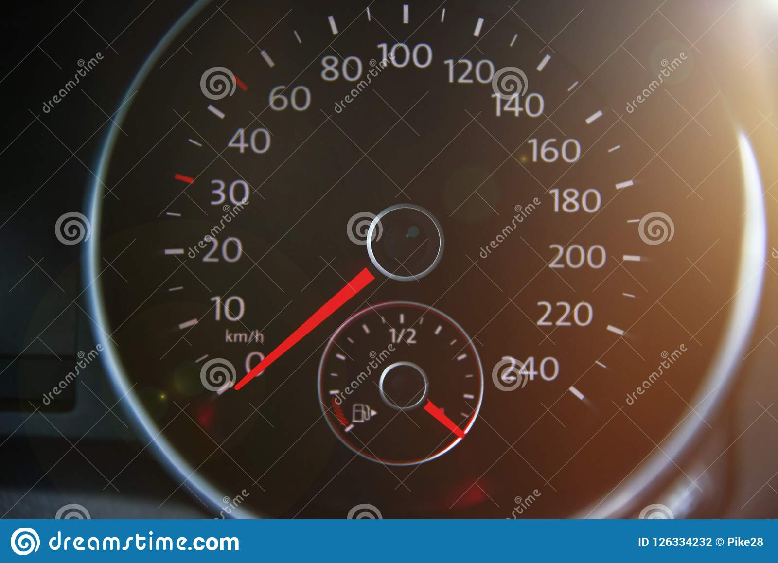 Closed up of full petrol gauge with lens flare.