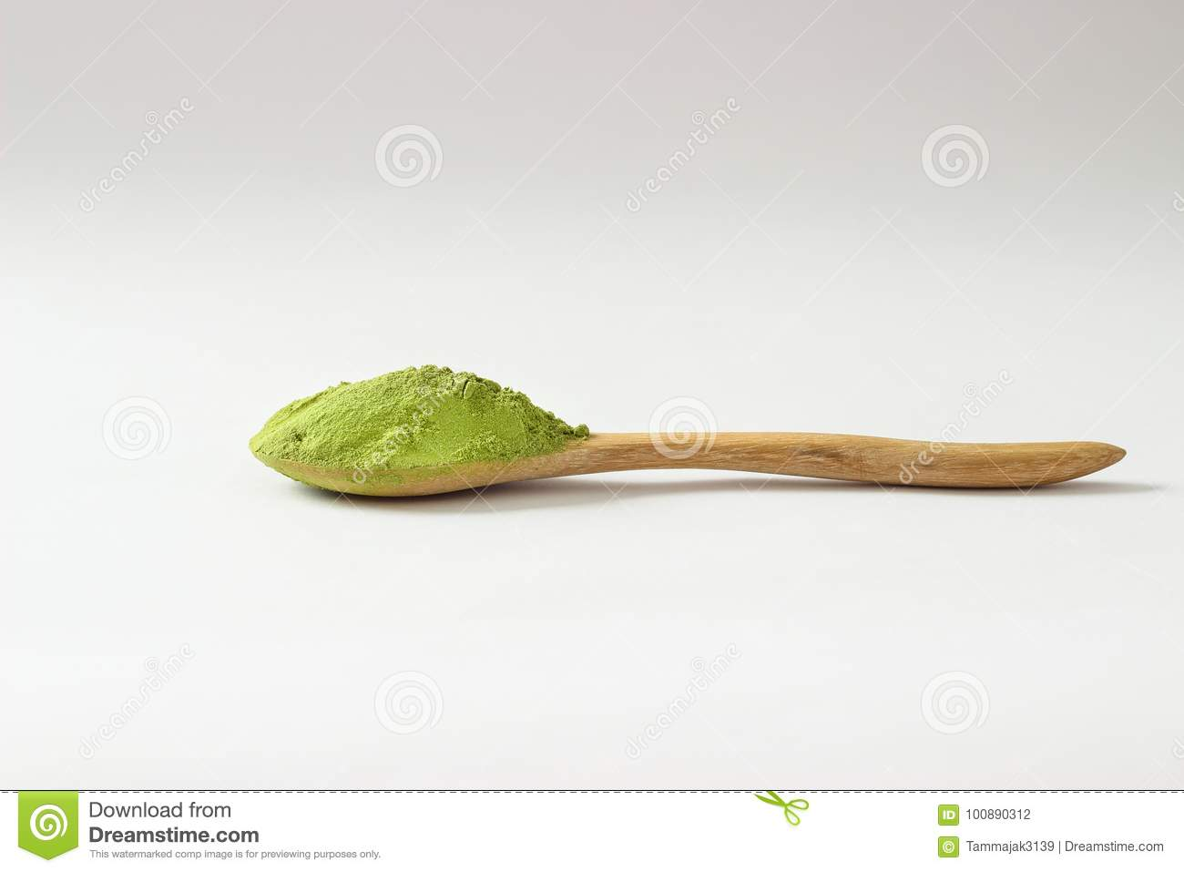 Closed Up Isolate Heap Of Extract Green Tea Powder In Wooden