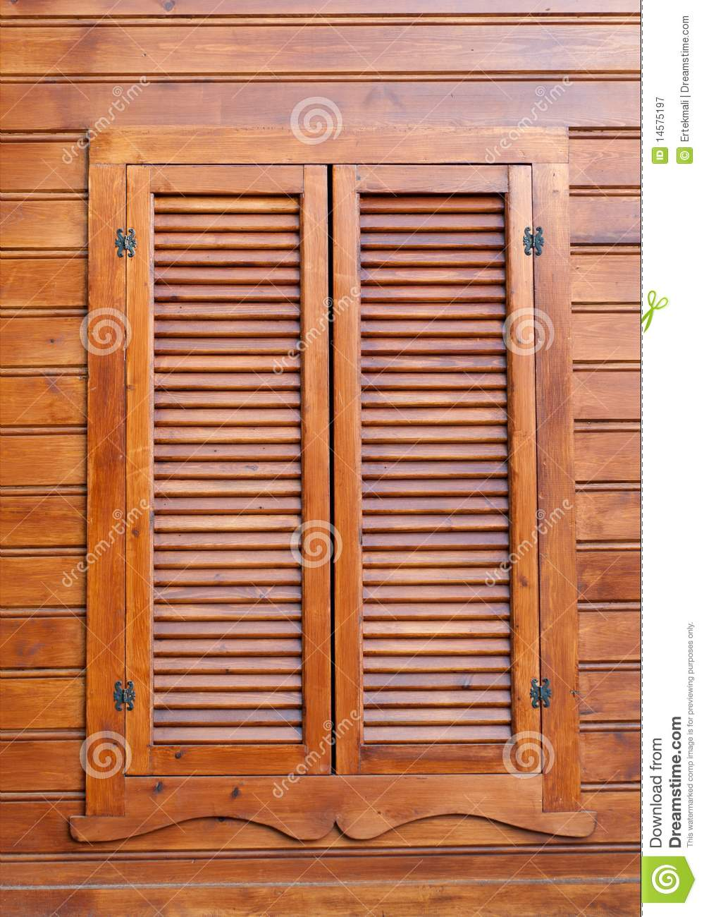 Wood Shutters Closed : Closed wooden shutters on a panneled wall stock