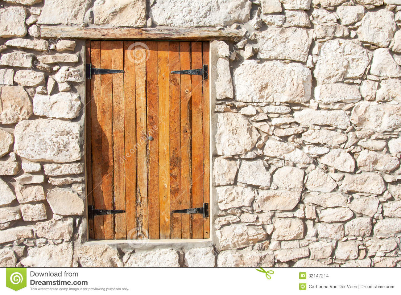 Closed Wooden Window And Shutters In Stone Wall Stock