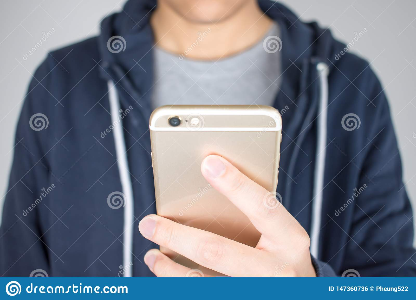 Close-up hands are holding the phones are shopping online