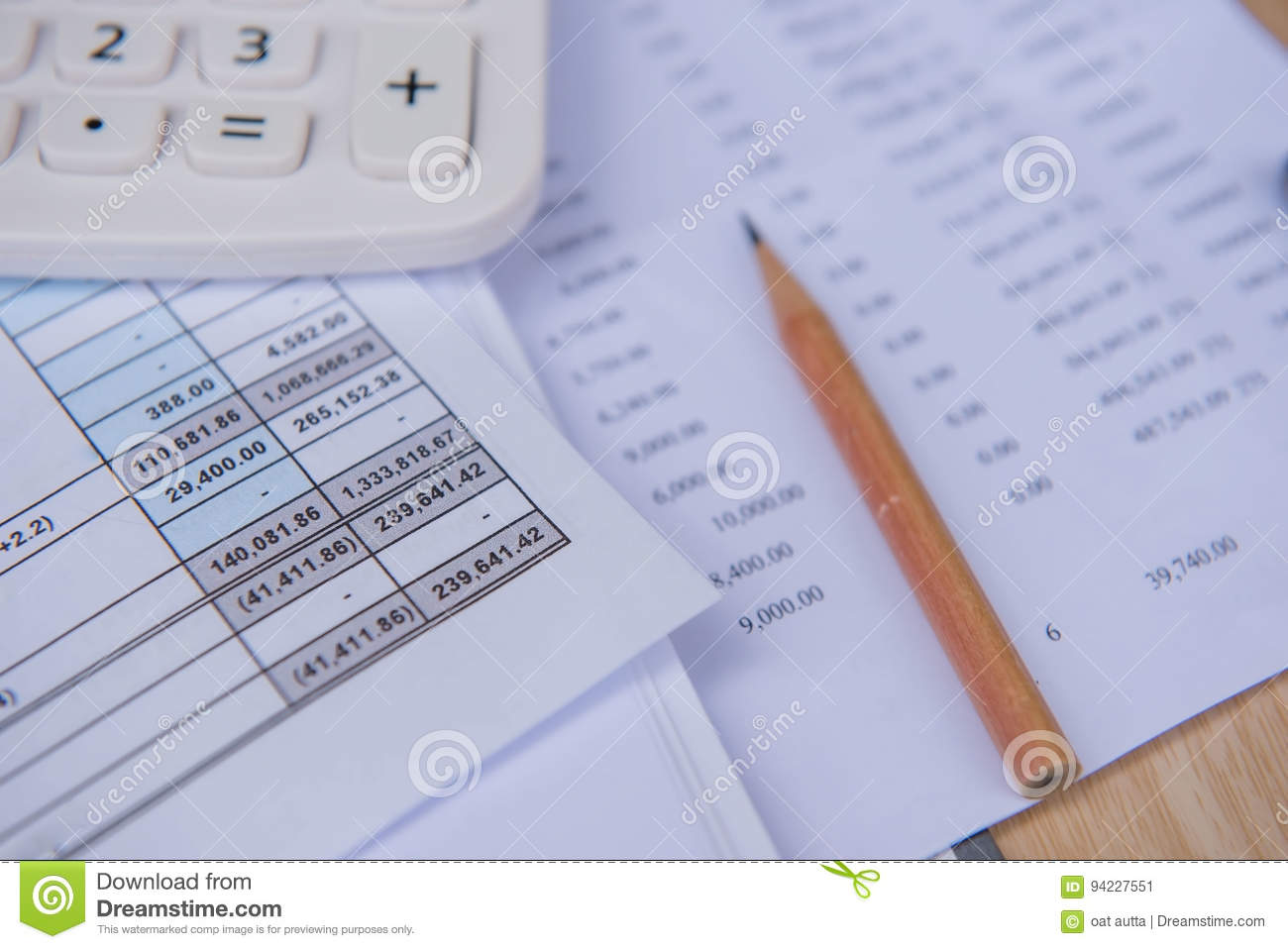 closeup accounts number on a printed paper calculator and pencil