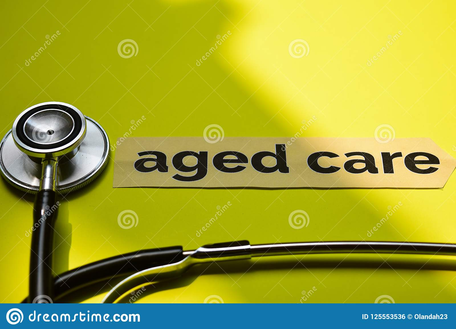 Closeup aged care with stethoscope concept inspiration on yellow background