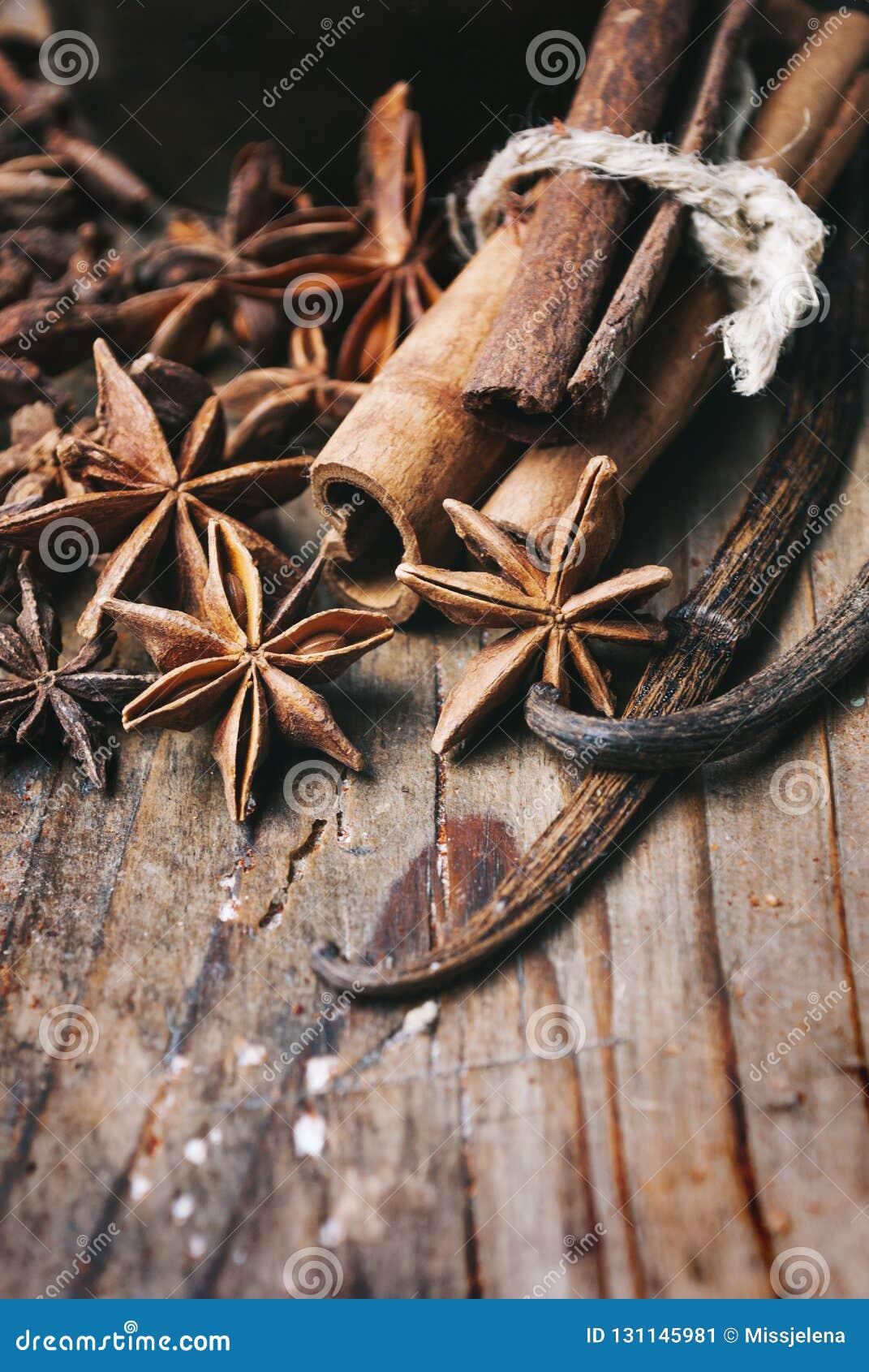 Closeup Of Anise Seed Vanilla And Cinnamon Sticks On Rustic